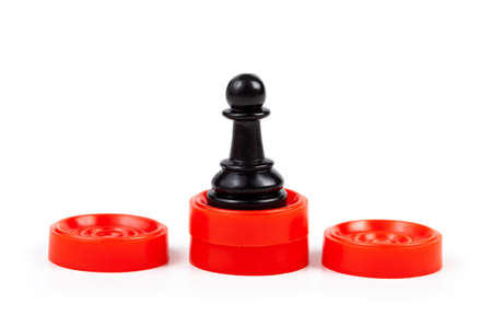 Simple black chess piece, pawn standing on a red podium, first place the best player, employee, winner, 1st place abstract business concept with game pieces isolated on white. Matchless, unparalleled