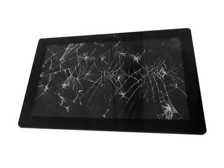 Mobile tablet device with a broken badly cracked shattered glass on the touch screen. Smart hardware part replacement, fixing concept