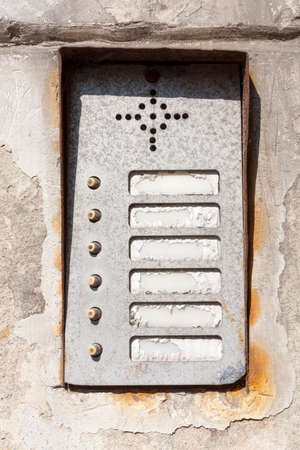 Old damaged worn vintage rusty apartment entry phone / Intercom panel with buttons high quality texture asset. Game texture grunge post apocalytpic assets Standard-Bild