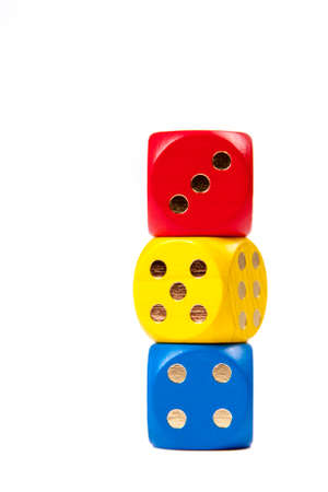 Three Dices in primary colours Stacked on top of each other isolated on white background, gambling or kids preschool numbers education concept 写真素材