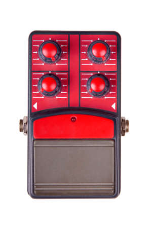 Red guitar effect pedal isolated on white background