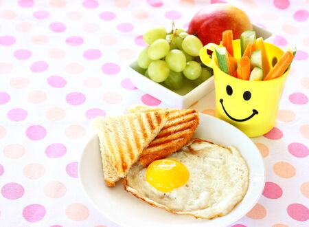 breakfast including egg, toast, fruits  photo