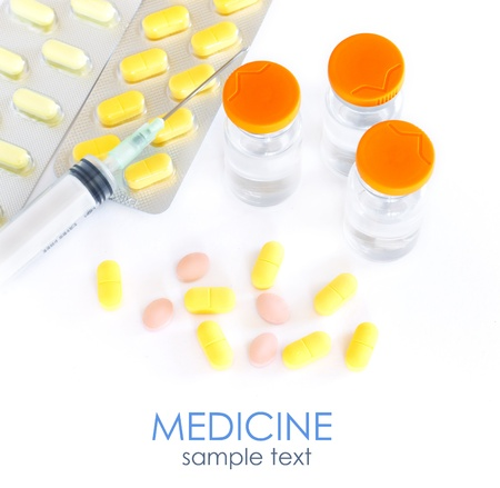 Stock Photo  Medical ampoules, syringe and pills  photo