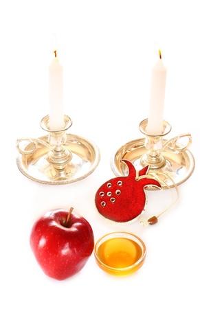 rosh hashanah concept - apple, honey and pomegranate  photo