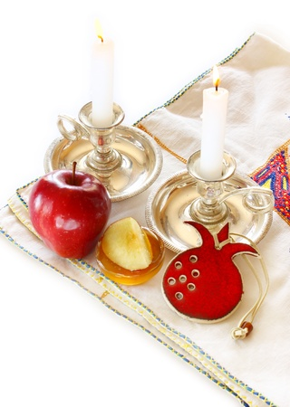 jewish food: rosh hashanah concept - apple, honey and pomegranate