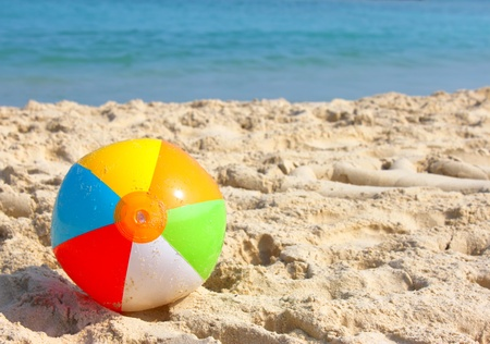 Day at the beach with a beach ball in the foreground  photo