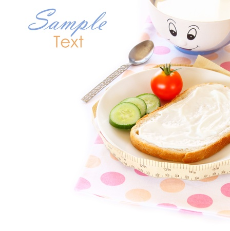 Healthy food for diet as bread and vegetables with measurement tape  photo