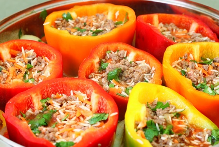 stuffed peppers in pot ready for cooking  photo