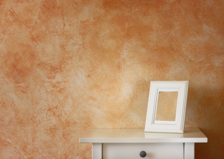 white classic frame against dark terracotta wall photo