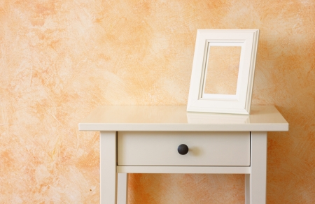 white classic frame against terracotta wall photo