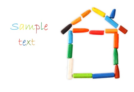house shape made from crayons  home concept family concept photo