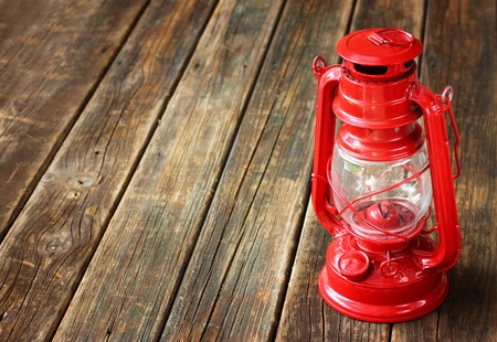red vintage lamp on wooden table  copy space   photo