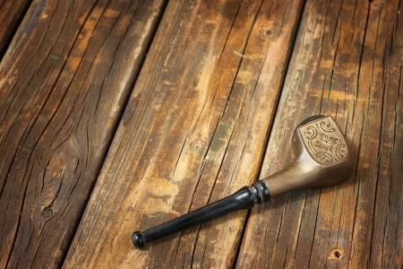 sherlock: vintage tobacco pipe on wooden table  Stock Photo