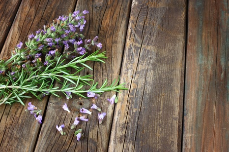 rosemary flower: fresh rosemary and sage on wooden table   Stock Photo