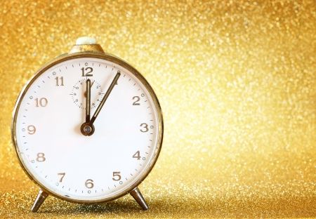 vintage clock with glittering golden background  photo