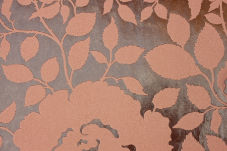 brown fabric background with floral pattern  photo
