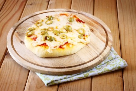 mini pizza: Mini pizza  homemade on wooden plate