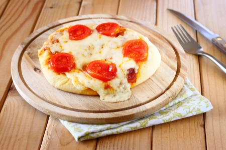 Mini pizza  homemade on wooden plate  photo