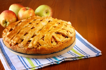Sugar apple: homemade apple pie on wooden table