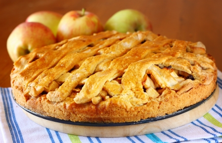 homemade apple pie on wooden table photo