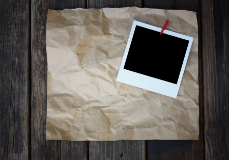 empty photo frame on brown paper photo