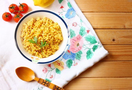 bulgur: cooked wheat on wooden table Stock Photo