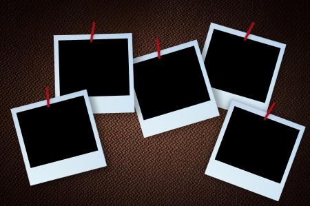 Polaroid photo frame on textured brown canvas