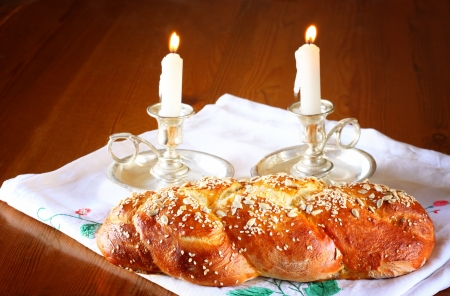 jewish food: Sabbath image  challah bread and candelas on wooden table