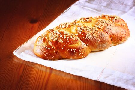 challah bread on wooden table photo