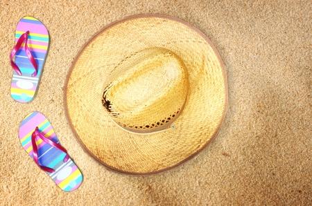 straw hat, flip flops on wooden background photo