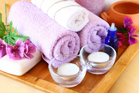 towels luxury: Spa and wellness setting with natural soap, candles and towel  natural wooden background