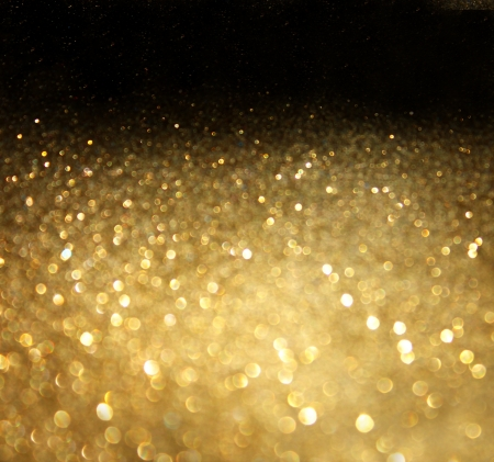 gold snowflakes: golden background of defocused abstract lights  golden bokeh lights