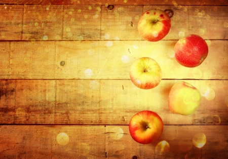 apples on wooden background with glitter lights  photo