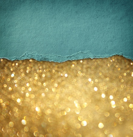 gold glitter background and blue vintage torn paper   room for copy space  photo