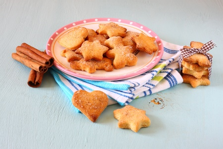 gingerbread cookies: Gingerbread cookies over blue wooden background Stock Photo