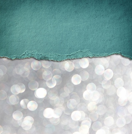 silver: silver glitter background and blue vintage torn paper   room for copy space