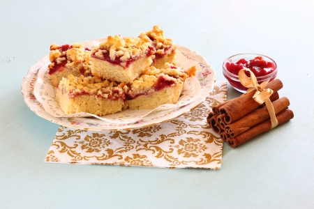 cherry cake, coffee cup and jam on wooden table background photo
