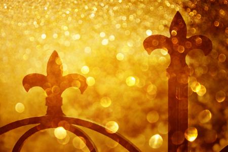 spears: iron fence spears and glitter gold light burst
