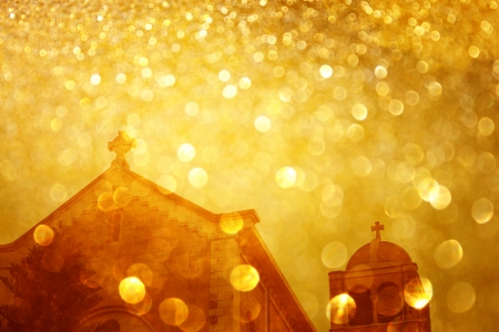 glitter golden lights glowing over cross photo