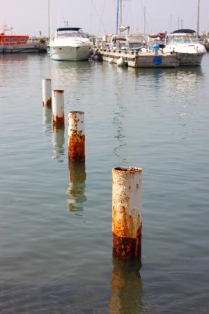 steel pole in sea water photo