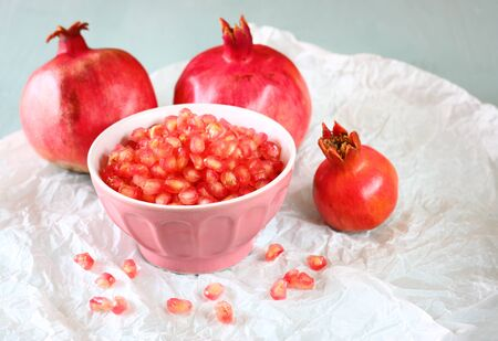 pomegranate on wooden table, and fresh pomegrante seed in bowl Stock Photo - 23366602