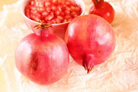 pomegranate on wooden table, and fresh pomegrante seed in bowl Stock Photo - 23366604