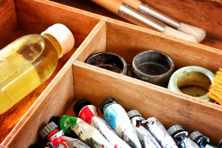 artist painting: painter wooden case with used oil tubes and brushes