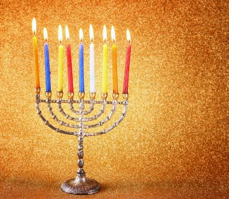 chanukah: Hanukkah menorah over glitter background Stock Photo