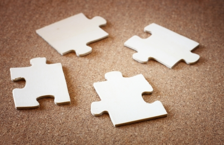 puzzle pieces on wooden background  business or team concept  selective focus   photo