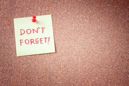 dont forget or do not forget reminder, written on Yellow Sticker on Cork Bulletin or Message Board  photo