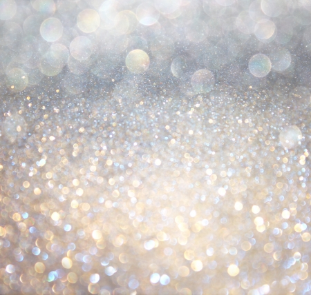 glimmer: white silver and gold abstract bokeh lights  defocused background   Stock Photo