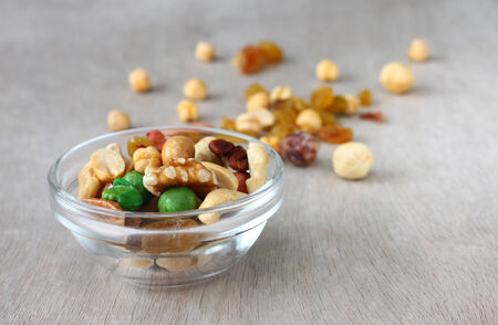 Assorted healthy mixed nuts on wooden textured background   Stock Photo - 24756768