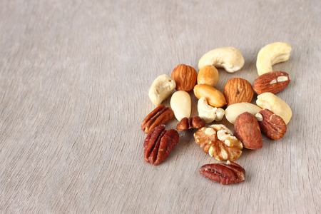 Assorted healthy mixed nuts on wooden textured background   Stock Photo - 24756810