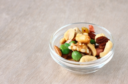 Assorted healthy mixed nuts on wooden textured background Stock Photo - 24756815